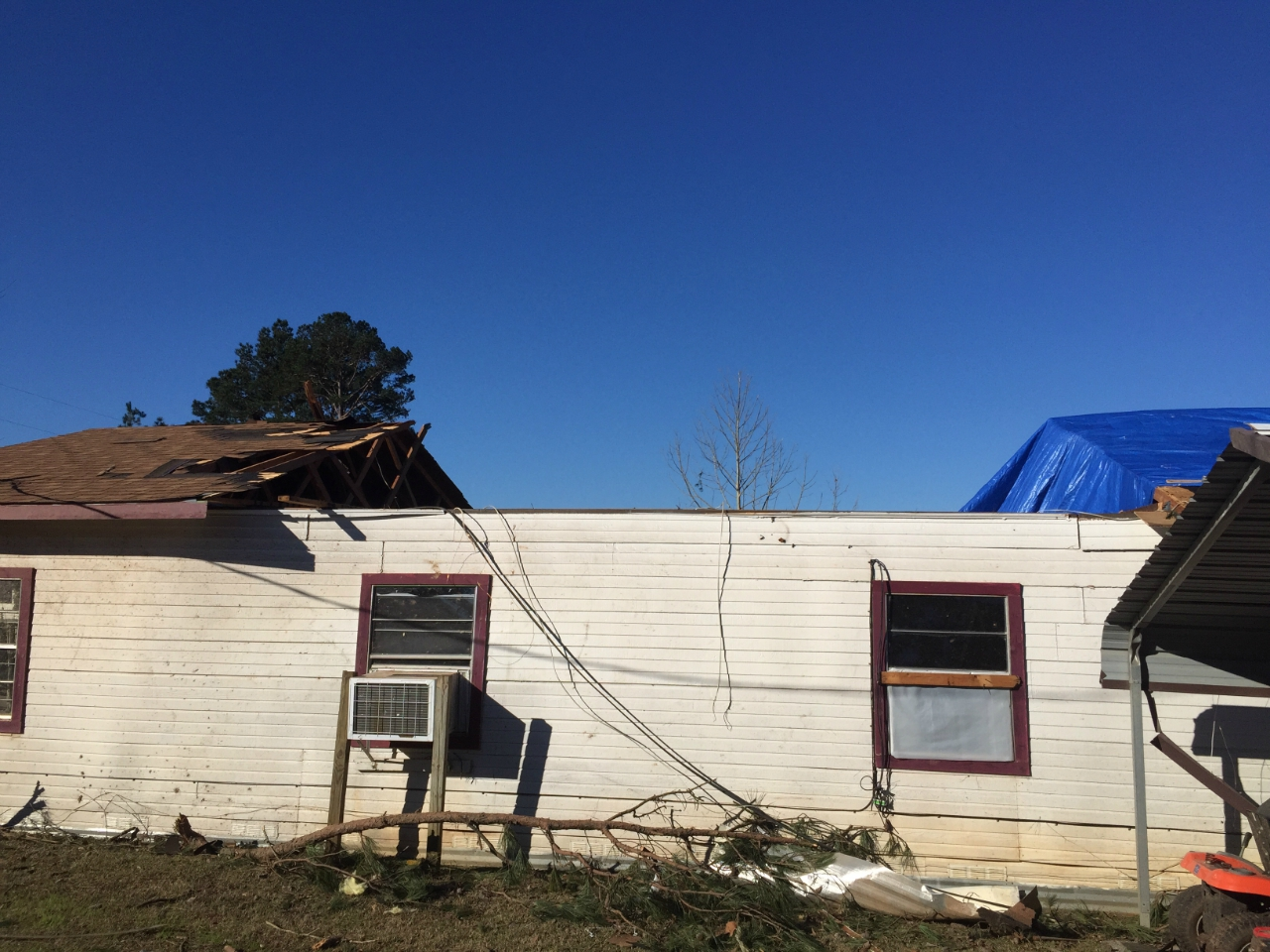 EF2 damage to a home near Scottsville, TX