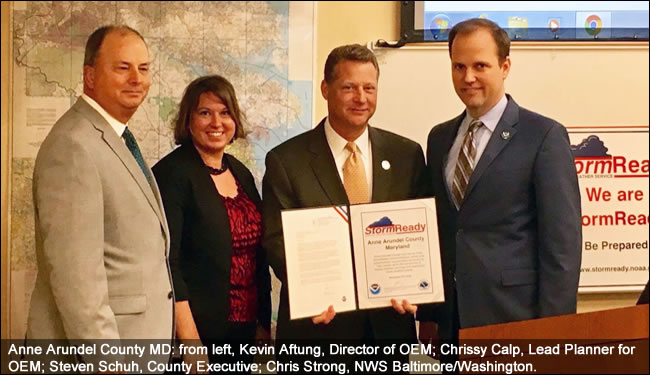 Anne Arundel County MD  Pictured: Kevin Aftung, Director of OEM; Chrissy Calp, Lead Planner for OEM; Steven Schuh, County Executive; Chris Strong, NWS Baltimore/Washington., Stormready recognition ceremony