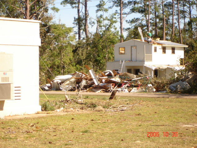This image depicts a home damaged by the tornado.
