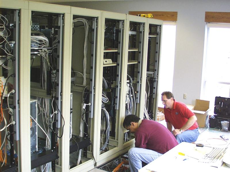 A picture of workers installing our mainframe AWIPS computer.