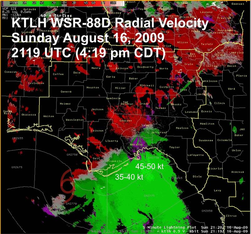 Tallahassee Doppler radar (KTLH) base velocity image on Sunday, 16 August at 2119 UTC (4:19 pm CST) with the center position of TS Claudette indicated.