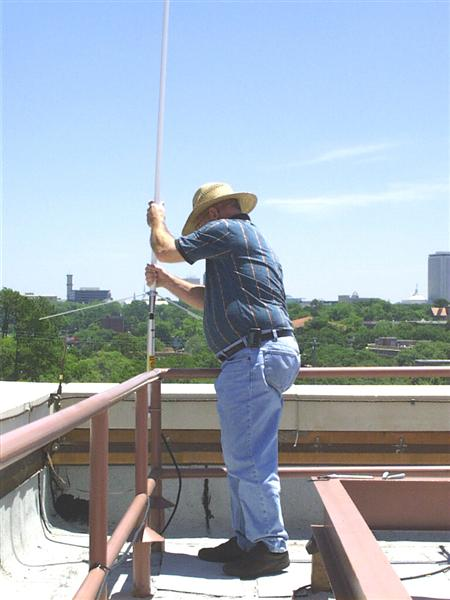 A picture of our HAM antenna begin installed on the roof.