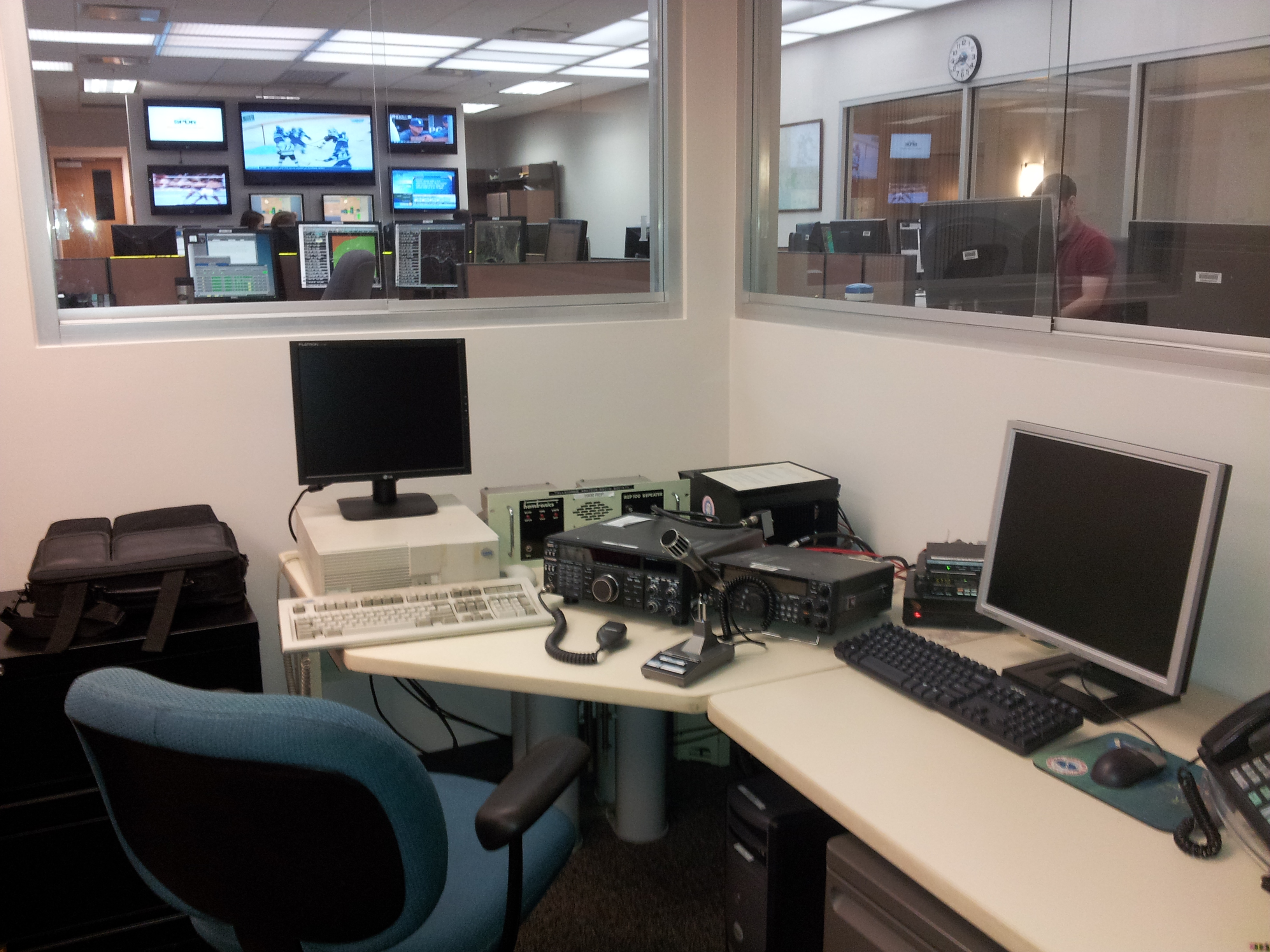 A picture of equipment in our HAM Network Control cubicle, located adjacent to the operations room.