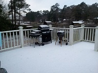 Snow and sleet accumulates on a porch in Lake Blackshear. Photo courtesy of Debbie Fullerton as posted on the WFXL Facebook page.