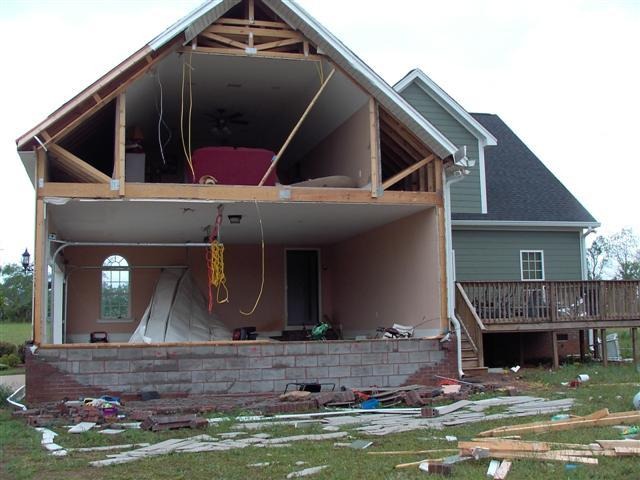 This image shows damage sustained by a home in Lee County, GA, from a tornado that struck on Saturday evening, April 14, 2007.