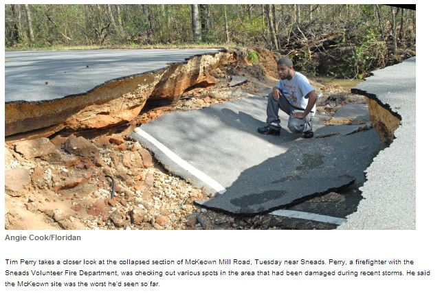 Tim Perry takes a closer look at McKeown Mill Road near Sneads, FL. Photo courtesy of <em>The Jackson County Floridian</em>.