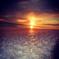 Ice covers a beach at sunset on Okaloos Island, FL. Photo submitted to NWS Mobile by Ama Wison via Twitter.