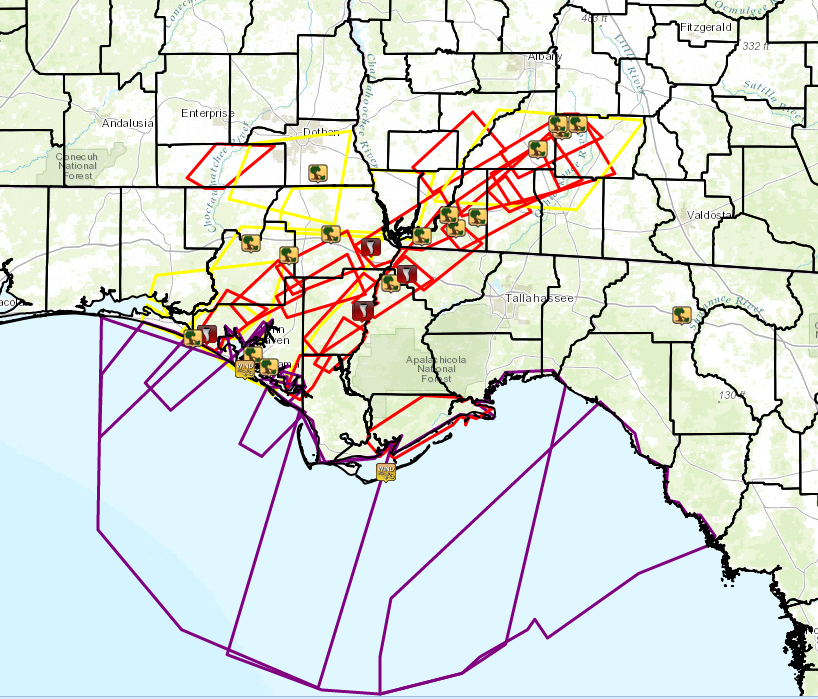 Map showing warning polygons and observed reports of severe weather that occurred on November 17, 2014. Polygons for tornado warnings (red), severe thunderstorm warnings (yellow), and special marine warnings (purple) are shown. Tornado and wind damage locations are indicated by the respective icons.