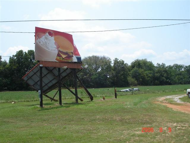 This image depicts damage to a billboard near Midland City, AL.