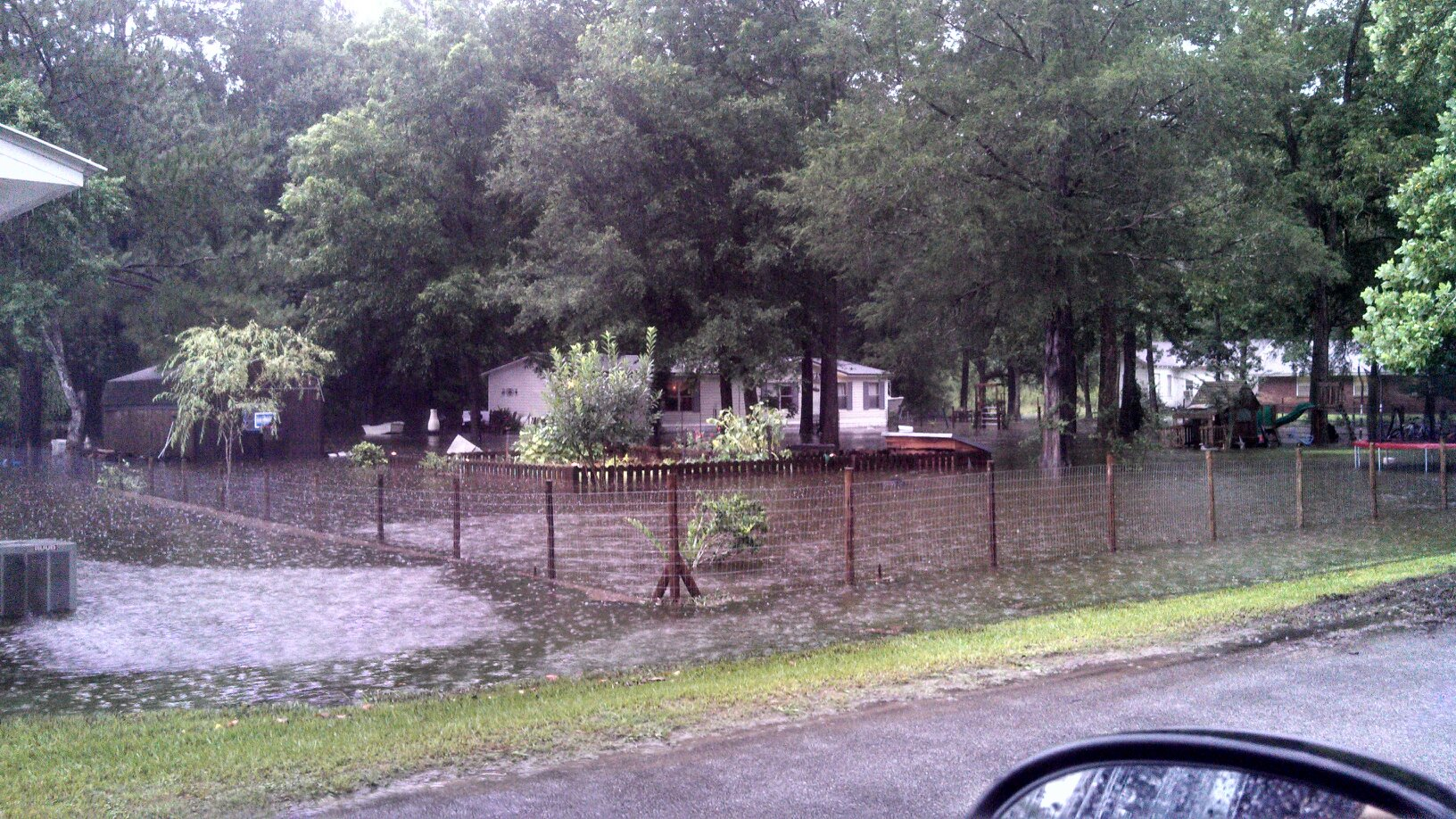 Flood waters surround a home in Vernon, FL on July 3, 2013.