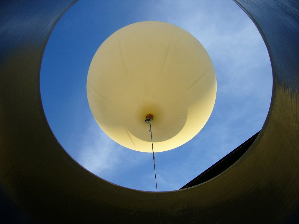 Photograph of the weather balloon before it is released through the rooftop launch tube.