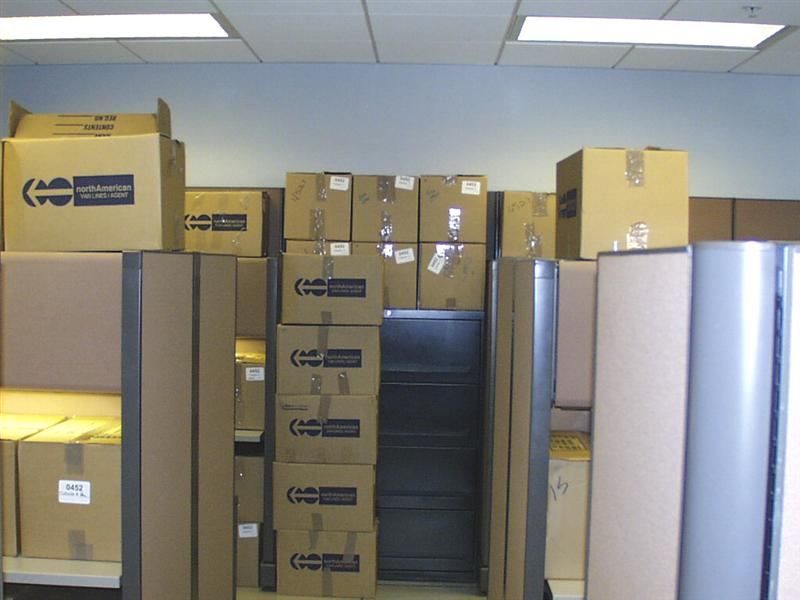A picture showing just a small percentage of the boxes that needed to be packed and unpacked.