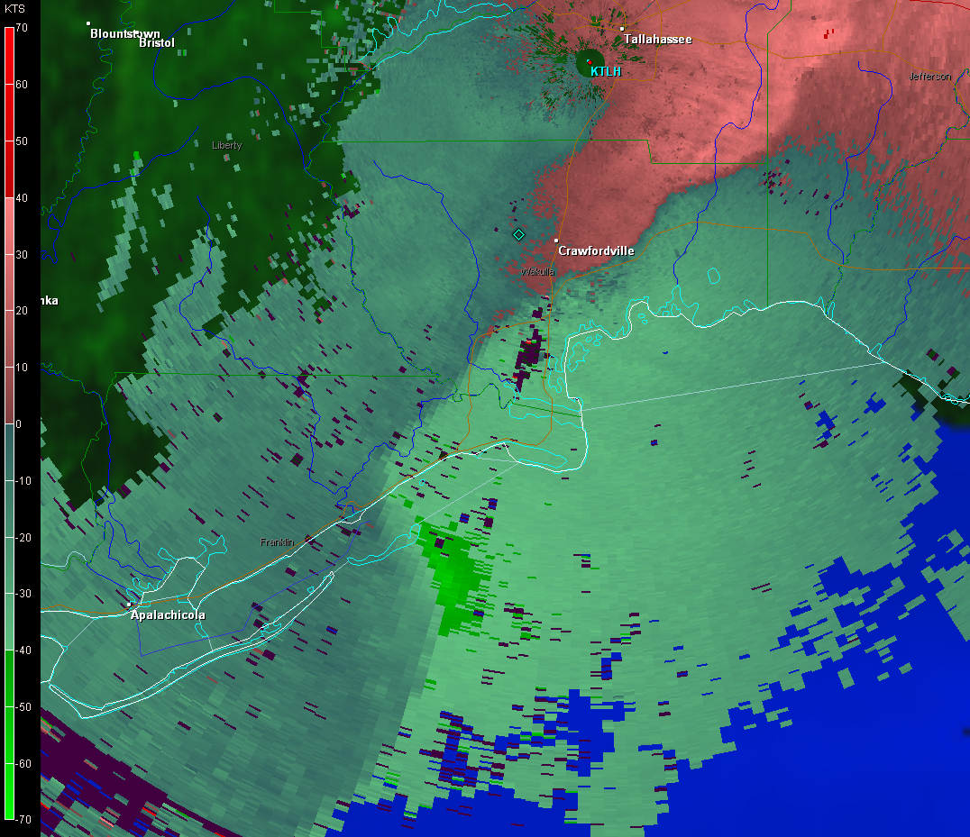 Base velocity image from the Tallahassee WSR-88D radar at 0237 UTC 16 December (937 pm EST 15 December) showing strong straightline wind signature associated with a bow echo moving along the Franklin County, FL coastline toward Alligator Point , FL.
