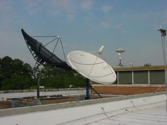 An photo of the Satellite Broadcast Network antenna that sits atop our office.