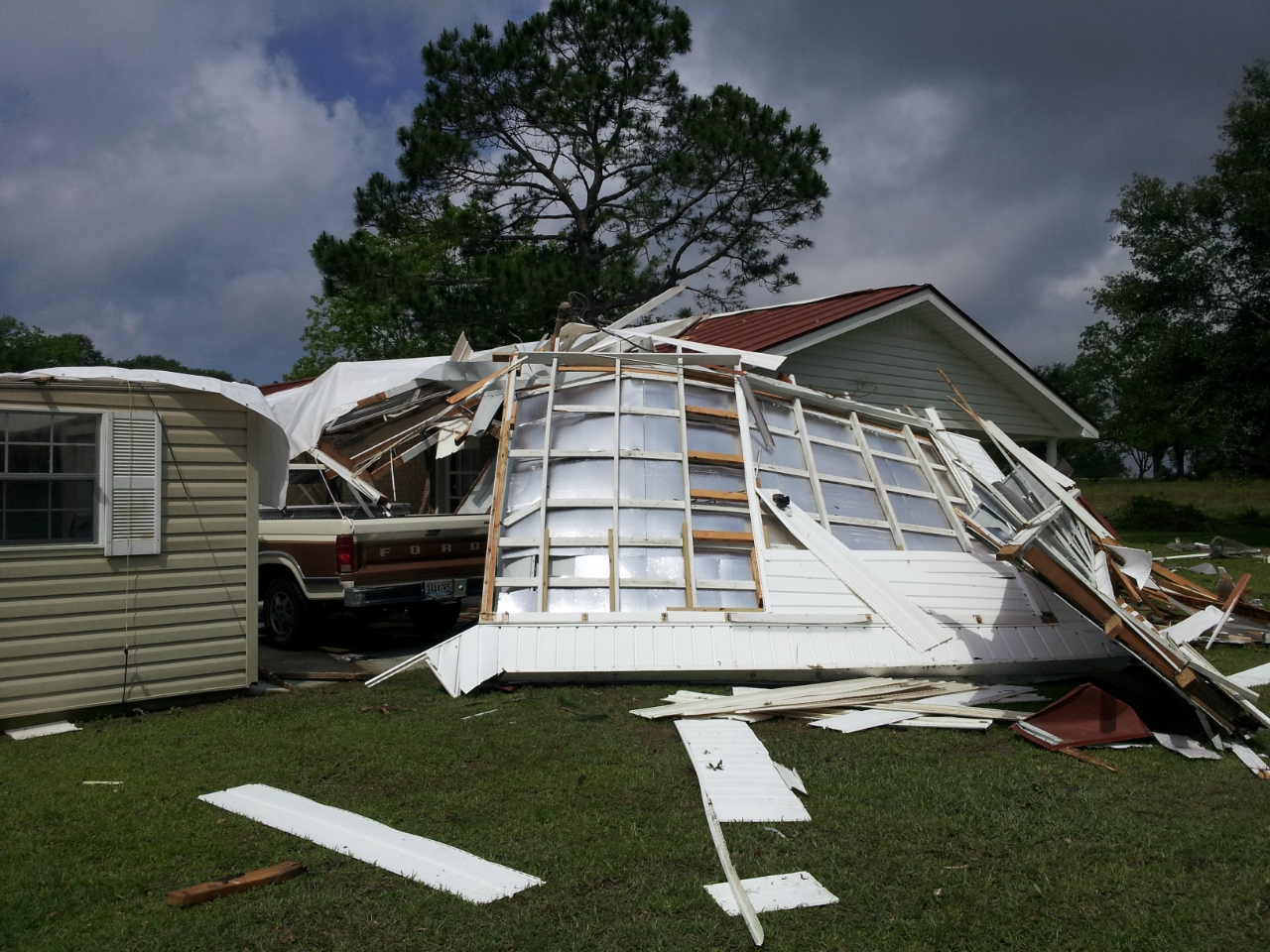 A home along County Road 9 in Geneva County damaged by an EF1 tornado on May 10, 2014.