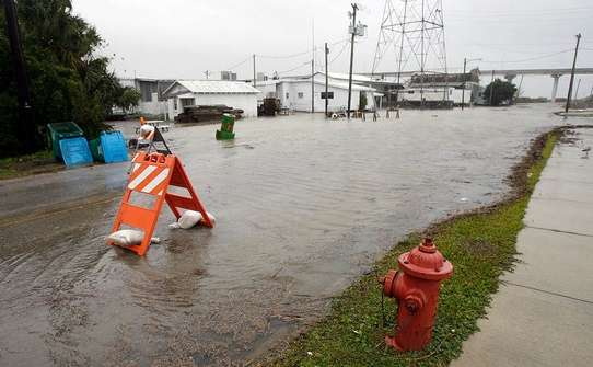 Flooding on Water Street in Apalachicola at high tide.