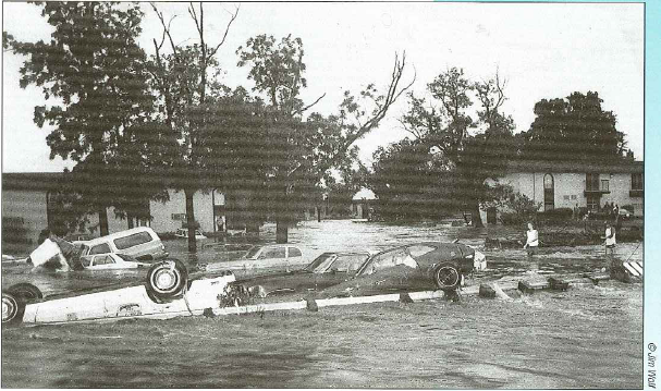 cars in flood waters along Mingo Creek tributary
